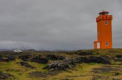 Μπροστά από τον πορτοκαλή φάρο Στοκ εικόνες με δικαίωμα ελεύθερης χρήσης