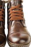 Μπότες δαντελλών των χειμερινών ατόμων με τη γούνα, που απομονώνεται στο άσπρο υπόβαθρο Στοκ εικόνες με δικαίωμα ελεύθερης χρήσης