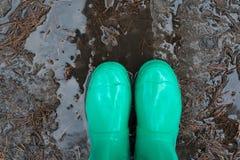 Μπότες βροχής στη λίμνη Στοκ εικόνα με δικαίωμα ελεύθερης χρήσης