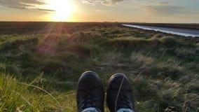 Μπότες με μια άποψη στο ηλιοβασίλεμα Στοκ φωτογραφία με δικαίωμα ελεύθερης χρήσης