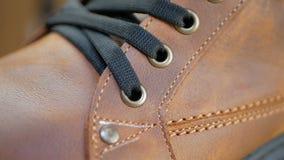 Μπότες χειμερινού καφετιές δέρματος ατόμων φιλμ μικρού μήκους