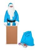 Μπλε Άγιος Βασίλης παρουσιάζει κενό πίνακα δελτίων Στοκ Φωτογραφία
