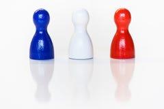 Μπλε, άσπρα, κόκκινα ειδώλια παιχνιδιών Στοκ Φωτογραφία