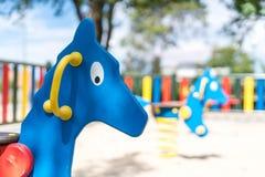 Μπλε άλογο λικνίσματος στην παιδική χαρά Στοκ φωτογραφία με δικαίωμα ελεύθερης χρήσης