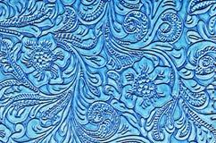 Μπλε δέρμα που αποτυπώνεται σε ανάγλυφο με ένα Floral σχέδιο Στοκ Εικόνες