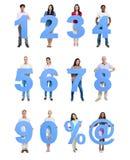 Μπλε αριθμός εκμετάλλευσης ομάδας ανθρώπων σε έναν υπόλοιπο κόσμο Στοκ Φωτογραφίες