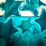 Μπλε αστέρια πάγου στο νερό Στοκ Εικόνες
