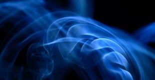 Μπλε αφηρημένο υπόβαθρο - καπνός στο Μαύρο. Στοκ Εικόνα
