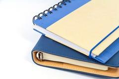 Μπλε βιβλίο σημειώσεων στο άσπρο υπόβαθρο Στοκ Εικόνα