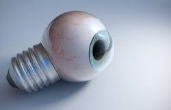Μπλε βολβός του ματιού σε μια βίδα λαμπών φωτός Στοκ εικόνες με δικαίωμα ελεύθερης χρήσης