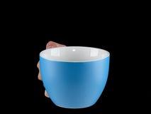 Μπλε - θαλάσσιο φλυτζάνι χρώματος - κούπα στο μαύρο υπόβαθρο Στοκ Εικόνες