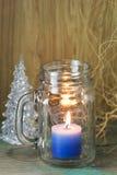 Μπλε κερί στο γυαλί μπουκαλιών Στοκ Φωτογραφία