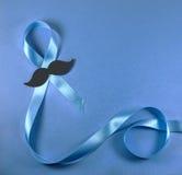 Μπλε κορδέλλα με το mustache Στοκ Φωτογραφίες