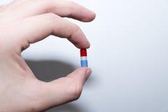 μπλε κόκκινο χαπιών Στοκ Εικόνες