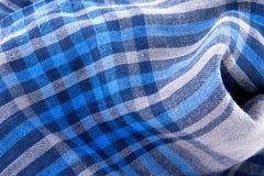 Μπλε κλωστοϋφαντουργικό προϊόν ελέγχου Στοκ Εικόνα