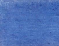 Μπλε κλωστοϋφαντουργικό προϊόν χρώματος surfacr με τα σημεία και τις γρατσουνιές Στοκ Εικόνα