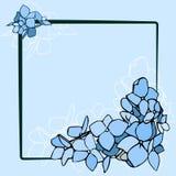 Μπλε λουλούδια στο μαύρο πλαίσιο Στοκ φωτογραφία με δικαίωμα ελεύθερης χρήσης