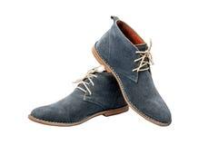 Μπλε παπούτσια σουέτ στο άσπρο υπόβαθρο Στοκ Φωτογραφία