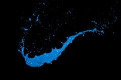Μπλε παφλασμός χρωμάτων στο μαύρο υπόβαθρο Στοκ Εικόνα