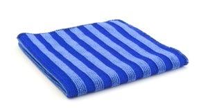 Μπλε πετσέτα για τα εργαλεία πλύσης που απομονώνονται Στοκ Εικόνες