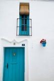 Μπλε πόρτα και παράθυρο στοκ φωτογραφίες