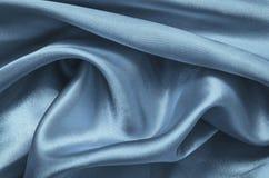 Μπλε σατέν σύστασης, μετάξι Στοκ φωτογραφία με δικαίωμα ελεύθερης χρήσης