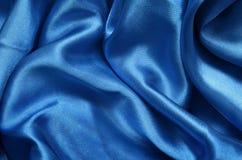 Μπλε σατέν σύστασης, υπόβαθρο μεταξιού Στοκ φωτογραφία με δικαίωμα ελεύθερης χρήσης