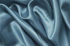 Μπλε σατέν σύστασης, υπόβαθρο μεταξιού Στοκ Εικόνες