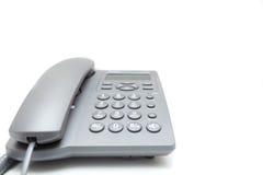 μπλε στενό τηλεφωνικό πλάνο γραφείων που τονίζεται επάνω Στοκ Εικόνες