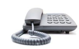μπλε στενό τηλεφωνικό πλάνο γραφείων που τονίζεται επάνω Στοκ εικόνα με δικαίωμα ελεύθερης χρήσης