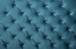 Μπλε σύσταση ταπετσαριών υφάσματος κιρκιριών σχηματισμένη τούφες capitone Στοκ φωτογραφίες με δικαίωμα ελεύθερης χρήσης