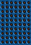 Μπλε υπόβαθρο με τις χρυσές σφαίρες Στοκ Εικόνες