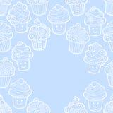 Μπλε υπόβαθρο με το χαριτωμένο doodle cupcakes Απεικόνιση αποθεμάτων