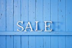 Μπλε υπόβαθρο πώλησης Στοκ εικόνα με δικαίωμα ελεύθερης χρήσης
