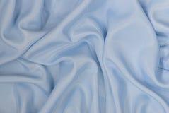 Μπλε υπόβαθρο σατέν Στοκ Εικόνες