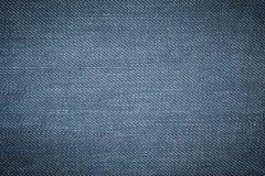Μπλε υπόβαθρο σύστασης του Jean τζιν Στοκ Φωτογραφία
