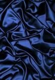 Μπλε υπόβαθρο υφάσματος σατέν Στοκ εικόνα με δικαίωμα ελεύθερης χρήσης
