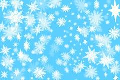 Μπλε υπόβαθρο Χριστουγέννων με μέρη των νιφάδων και των αστεριών W χιονιού Στοκ Εικόνες