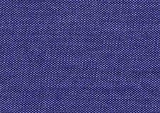 Μπλε υφαντικό υπόβαθρο, ζωηρόχρωμο σκηνικό Στοκ Φωτογραφία