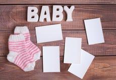 Μωρό λέξης και λευκιά φωτογραφία πλαισίων Στοκ φωτογραφία με δικαίωμα ελεύθερης χρήσης
