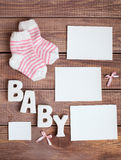 Μωρό λέξης και λευκιά φωτογραφία πλαισίων Στοκ Φωτογραφίες