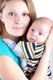 μωρό αυτή που κρατά λίγο γ&lambda Στοκ Φωτογραφία