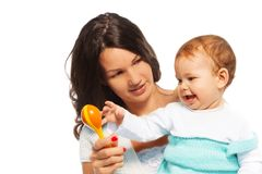 Μωρό και κουδούνισμα μητέρων στοκ φωτογραφία