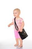 Μωρό με μια τσάντα στην άσπρη ανασκόπηση στοκ εικόνα