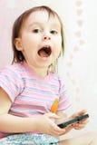 Μωρό με το τηλέφωνο της Mobil Στοκ Εικόνα
