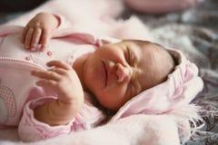 μωρό που ανατρέπεται Στοκ Φωτογραφία