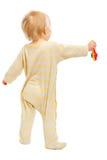 Μωρό που στέκεται με το κουδούνισμα πίσω στη φωτογραφική μηχανή στοκ φωτογραφίες