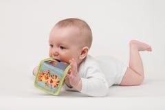 Μωρό σε μια άσπρη ανασκόπηση Στοκ Εικόνα