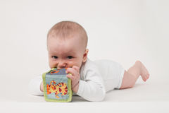 Μωρό σε μια άσπρη ανασκόπηση Στοκ Φωτογραφίες