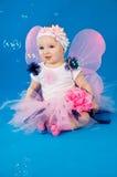 Μωρό στις νεράιδες κοστουμιών Στοκ Φωτογραφίες